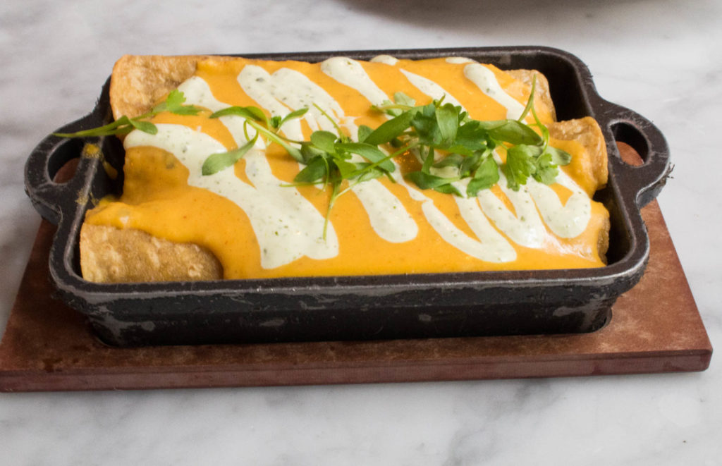 Chorizo Enchiladas from Wright & Co in Detroit, MI combines roasted peppers, leeks, and butternut squash. Find the full post at www.thebite2night.com
