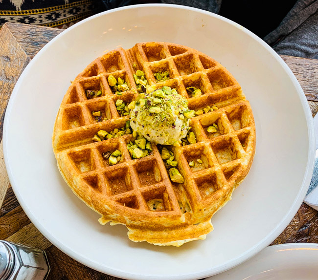 The Classic Waffle from Folk in Detroit is served with a dollop of pistachio butter and is absolutely delightful. Find the full post at www.thebite2night.com