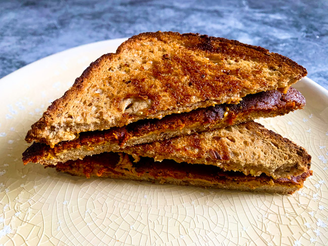 This Vegan Peanut Butter & Bacon Sandwich uses plant based hickory and sage bacon, creamy peanut butter, and a hearty multigrain bread. Find the full post at www.thebite2night.com