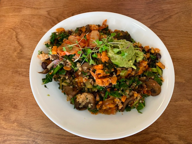 The Power Bowl from Juicy Kitchen is packed full of good stuff including sweet potato, kale, black beans, kimchi, caramelized onions, mushrooms, organic quinoa. Check out the full post at www.thebite2night.com